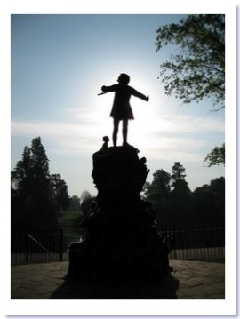 image silhouette of Peter Pan statue
